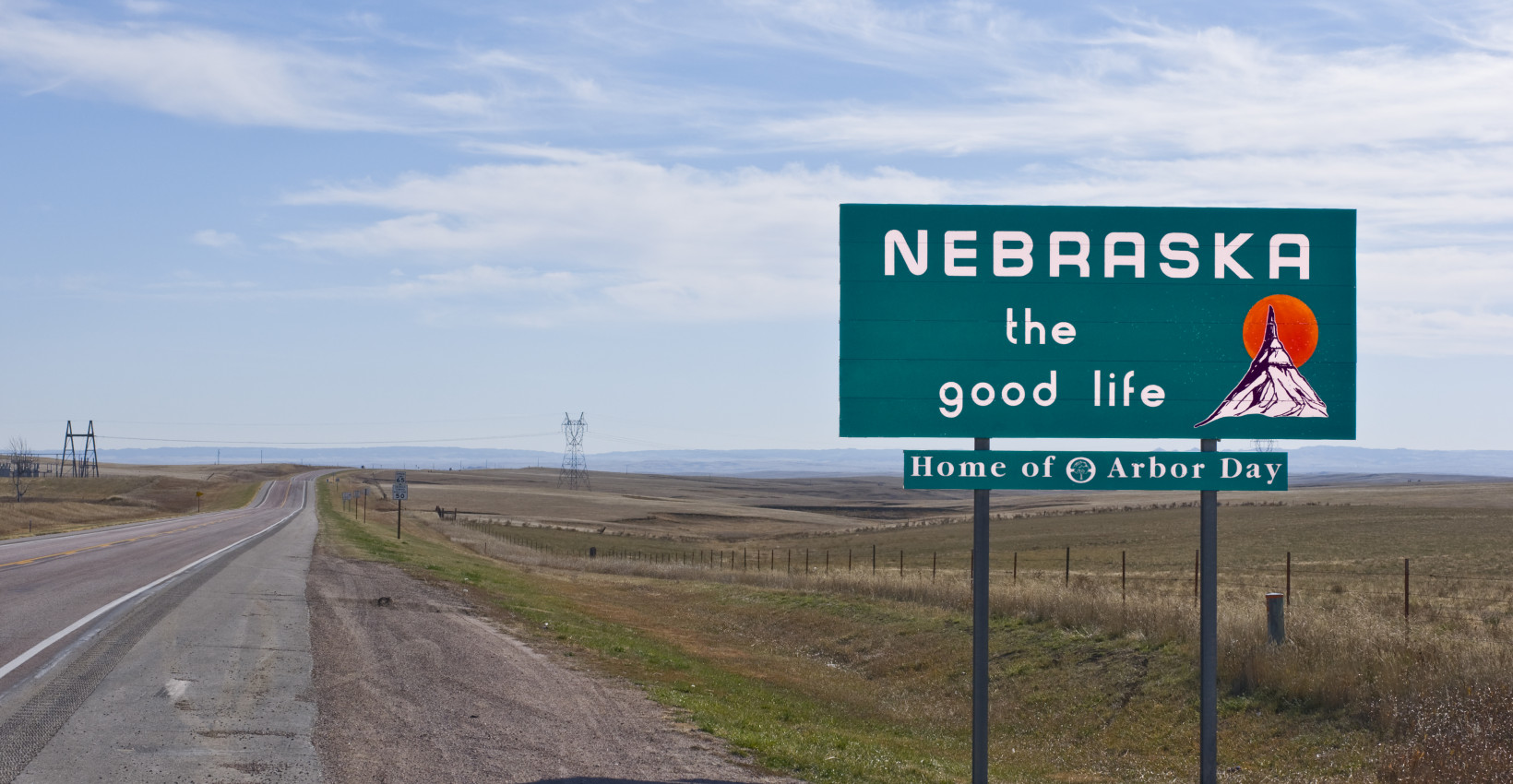 Nebraska the good life road sign on a highway.