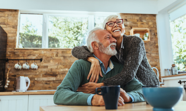 Retired couple hugging