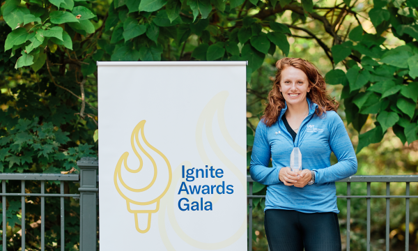 Samantha Dolezal in front of Ignite Awards Gala sign.